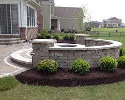 Building A Raised Patio With Retaining Wall by Raised Patio With Seat Wall And Firepit Installed By Brick