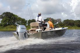 how to decide between a two or four stroke outboard boat engine
