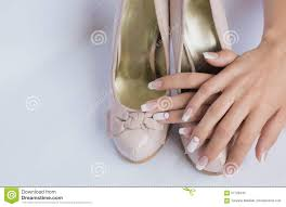 beautiful female hands with french manicure nails stock images