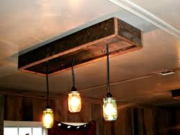 diy mason jar light with iron pipe diy ceiling lighting mason jar chandalier made from old barn wood
