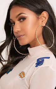 big ear rings gold big twisted metal hoop earrings prettylittlething