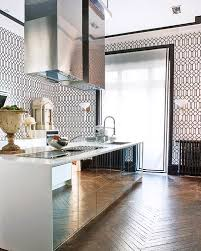 mirrored kitchen cabinets mirrored kitchen cabinets herringbone floors graphic wallpaper