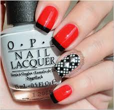 red nails with black french tips black and white raster design