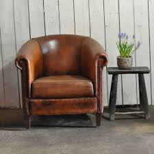swivel upholstered chairs chairs vintage worn french leather club chair with arms chairs
