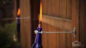 how to make a tiki torch from recycled bottles build com design