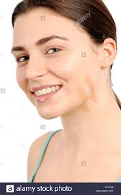 female brunette hair off face two stripes of foundation on chin