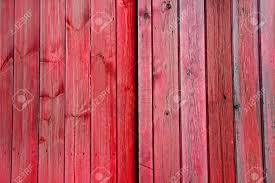 red and pink faded wooden doors planks panels vertical