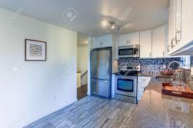 blue kitchen cabinets brown granite l shape kitchen room design with white cabinets brown granite