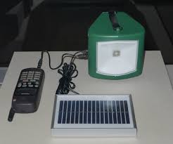 file ahotwsolar powered lamp and charger jpg wikimedia commons