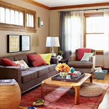 five ways to decorate with a brown sofa yellow pillows wall