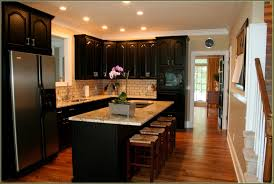 delightful maple kitchen cabinets with black appliances alluring