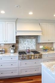 Kitchen Tile Backsplashes by Fantasy Brown Granite With Backsplash Sw Repose Gray Paint