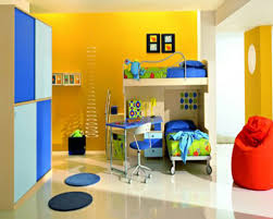 bedroom white bunk bed blue study table blue chair yellow paint
