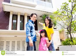 chinese family in front of house stock photo image 50627840