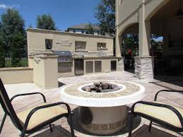 outdoor kitchen fire pit buff flagstone storage box stucco