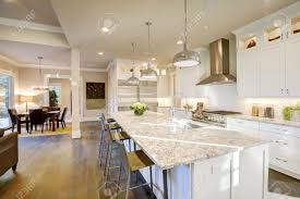kitchen islands with granite countertops white kitchen design features large bar style kitchen island stock