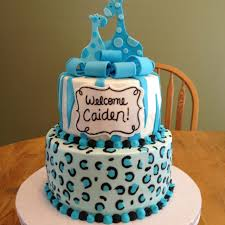 iced in fondant cheetah and zebra print the cake is topped with a