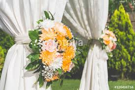 wedding decoration with ladders and flower arrangement