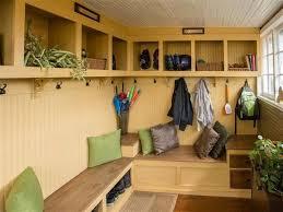 cottage mud room with hardwood floors u0026 built in bookshelf in