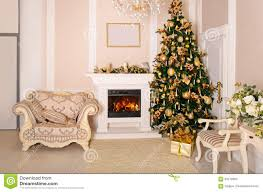 luxurious interior with white christmas tree and fireplace stock