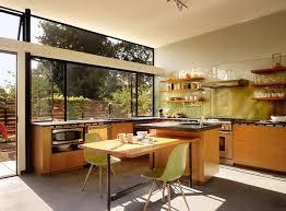 kitchen window backsplash window backsplash white countertop island black pendnat light