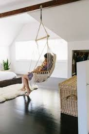 hanging swing chair bedroom a whimsical hanging chair in natural rattan the garden swing