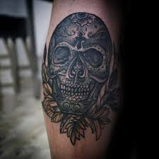 collection of 25 sugar skull on arm