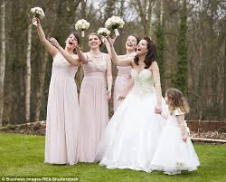 matching wedding dresses the reason why bridesmaids wear matching dresses daily mail