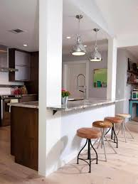semi modern kitchen the way is divided from living room but still like semi open