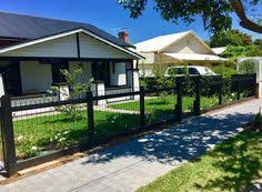 ornamental woven wire loop fence gives a historic look to fencing