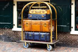 suitcases a few vintage suitcases on a trolley stock photo picture and