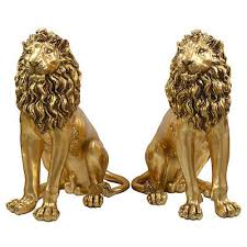 gold lion statue lion statue big cat king of the jungle beasts
