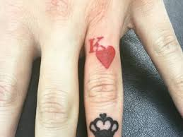 red ink nice king with black heart tattoo on finger golfian com