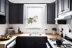 countertops black paneled cabinets butcher block countertop white