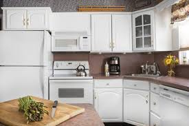 Repair Kitchen Cabinet How To Repair Laminate Cabinets Hunker