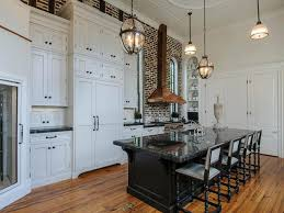 decor two tone kitchen cabinets and pendant lighting with tile