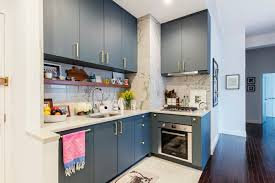 blue kitchen backsplash white cabinets eight blue kitchens that prove the color is a new classic