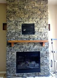 installing stone veneer over fireplace diy surround stacked facing