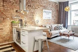 brick wall apartment small stylish apartment that looks warm cozy and inviting bricks