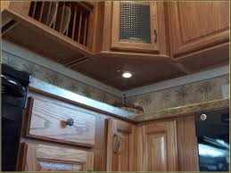 Installing Under Cabinet Puck Lighting by Under Cabinet Puck Lighting Home Design Ideas