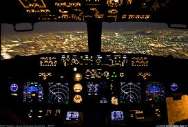 the view from the cockpit of an aeromexico 737 over mexico city at