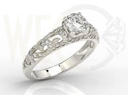 pierscionek zareczynowy pierścionek zaręczynowy z białego złota z białym szafirem i
