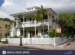 two storey building old historic wooden two storey building with white picket fence
