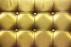 Gold Leather Sofa Closeup Texture Of Vintage Gold Leather Sofa For Background Stock