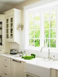 window modern kitchen with white kitchen cabinets and kitchen