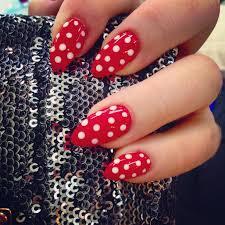 red almond shaped gel nails white polka dots nail art