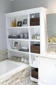 white vanity bathroom ideas built in open cabinet bathroom storage for artwork display beside
