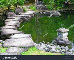 japan zen path garden pond surrounded stock photo 67421749