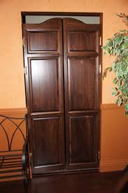 classic brown wooden three panels double interior swing door with
