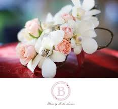 white orchid corsage corsage boutineers and flower white orchid pink roses